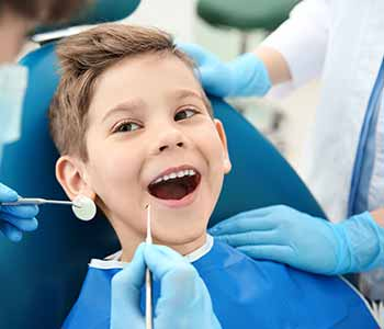 How are white, tooth colored fillings done for Greensboro area children?